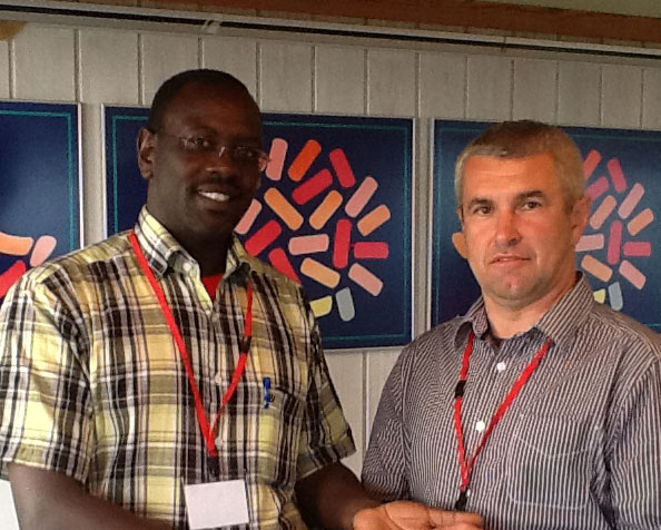 Richard-Aiyabei,-Kenya---receiving-World-Ploughing-Badge-as-a-new-Board-Member-2015